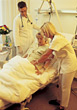 Medical Photos Doctor and Nurse at Hospital Bed stock photo