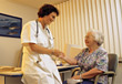 Doctor with Elderly Patient stock photo
