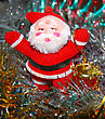 Doll Of Santa Claus With A Red Drum Against A Tinsel stock photography