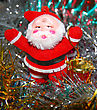 Doll Of Santa Claus With A Red Drum Against A Tinsel stock photo