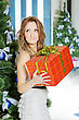 Dreamy Young Woman With A Christmas Present In The Orange Box