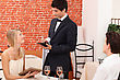 Dressy Couple Ordering In A Chic Restaurant stock photography