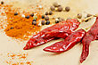 Various Dried Peppers And Other Kind Of Peppers Spices On A Brown Background stock photo