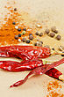 Dried Peppers And Other Kind Of Peppers Spices On A Brown Background stock photography