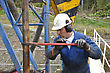 Drilling Crewman Tightens Pipe On Drillstring stock photography