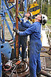 Geology Drilling Crewmen Position Pipe On Drillstring stock photo