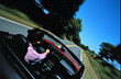 Action Driving in a Convertible stock photography