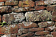 Dry stone is a building method by which structures are constructed from stones without any mortar to bind them together stock image