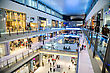 Brand DUBAI, UAE - NOVEMBER 14: Shoppers At Dubai Mall On Nov 15, 2012 In Dubai. At Over 12 Million Sq Ft, It Is The World's Largest Shopping Mall Based On Total Area And 6th Largest By Gross Leasable Area stock photo