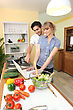 Duo In The Kitchen stock photography