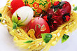 Easter Colorful Candle Eggs Nest On Gray Background. stock photo