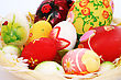 Easter Colorful Candle Eggs Nest On Gray Background.