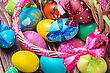 Easter Eggs In Brown Basket. Focus On The Pink Bow And Handle Basket