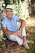 Elderly Man Relaxing In His Garden stock photography