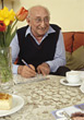Elderly Man Solving Crossword Puzzle stock image