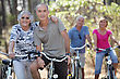 Biking Elderly People Riding Their Bikes stock photo