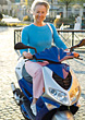 Elderly Woman Riding A Scooter stock photo