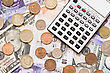Discount Electronic Calculator On A Different Currency Background stock photo