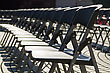 Empty Black Plastic Chairs Array In Row stock photo