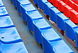 Empty Blue And Red Stadium Seats stock photography