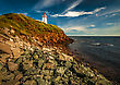 Eroded Beach Cliff And Lighthouse Prince Edward Island Canada