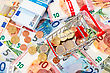 Euro Currency And Shopping Cart. Concept For Purchasing Power, Shopping, Money Printing And Inflation stock photo