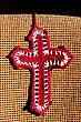 Fabric bookmark in a shape of the cross stock photo