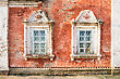 Facade Of An Old Russian Church With Two Windows stock photo