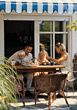 People Eating  Family Breakfast on Patio stock photography