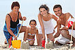 Family Building Sandcastles On The Beach
