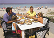 Family Dinner on Beach Vacation stock photography