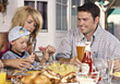Family Having Meal on Patio stock image