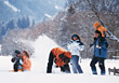 Family Having Snowball Fight stock photography