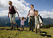 Family Hiking In The Mountains stock photo