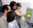 Family in Front of Computer