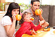 Family Inflating Balloons For Halloween stock photo