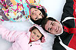 Joyful Family Laying In The Snow stock photography