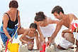 Family Making Sandcastle stock image