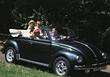 Buggy Family Making Trip in Convertible Beatle stock photo