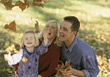 Family Playing with Fall Leafs stock photography