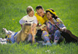 Family Sitting in Grass stock photo