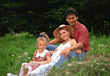 Family Sitting in Grass stock photography