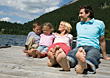 Family Sitting On A Pier stock photography