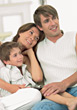 Family Sitting On Couch stock photography