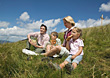 Family Sitting on Hill stock photo