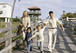 Happiness Family Walking on Boardwalk stock photo