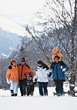 Family Walking Through Snow stock photo