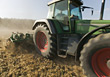 Farm Tractor Plowing Field stock image