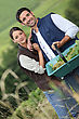 Farmer Couple In Field With Basket Of Grapes stock image