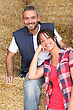 Fodder Farming Couple Sitting On Hay stock photography